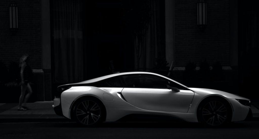 a supercar in dark shades